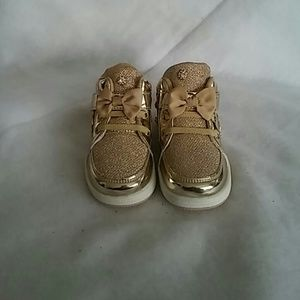 Other - A gold color pair of bling out kids sneakers